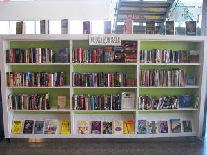 Used book sale shelves at Sam Garcia Library