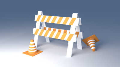 Orange and white construction barrier with cones