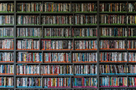 DVDs lined across floor to ceiling shelves